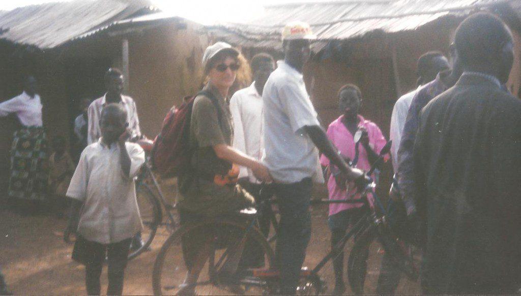 Maura Sweeney travels by bike on island in Uganda, Africa