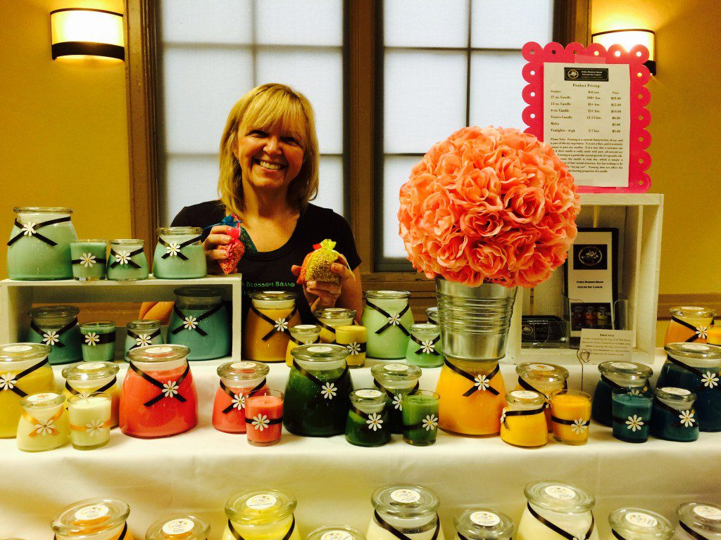 Owner Sandi Roper with her divinely inspired Citrus Blossom Scented Soy Candles