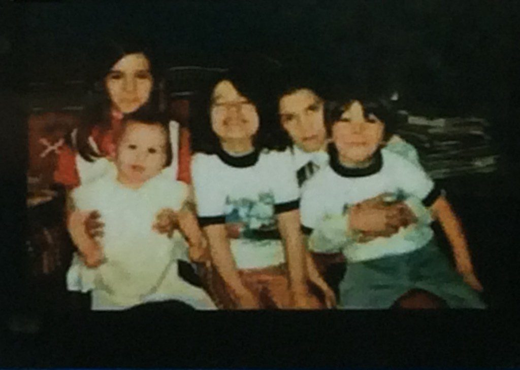"A photo of Regina and her siblings, one of several ""treasures"" she managed to carry with her throughout childhood."